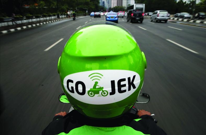Kết quả hình ảnh cho Go-Jek và Didi Chuxing.