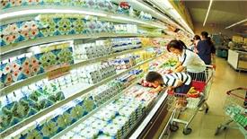 Các công ty sữa tìm cách đối phó với nhu cầu sữa tăng chậm